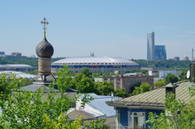 """View From The Observation Deck Of The Russian Academy Of Sciences To The Dome Of The St. Andrew's Monastery Church And The Large Sports Arena """"Luzhniki"""", Moscow, Russia"""