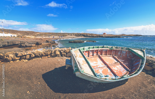 Fototapety, obrazy: Boat on the coast of Tenerife with a landscape of a beautiful beach in the Canary Islands.