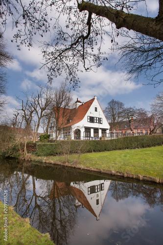 Poster Brugge Brugge - medieval house over a canal in Bruges, Belgium