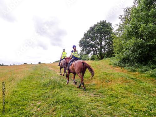 Fotografie, Tablou Two women horse riding on Chorleywood Common, Hertfordshire