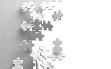 Exploding Jigsaw Puzzle On Whi...