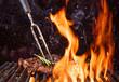 Leinwandbild Motiv Beef steak on the grill with flames