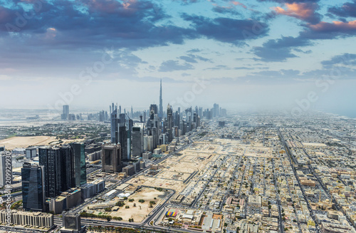 In de dag Stad gebouw Aerial view of modern skyscrapers and sea in the background in Dubai, UAE.