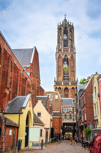 Deurstickers Brugge Traditional old buildings and tower of the Dom cathedral in Utrecht, Netherlands.