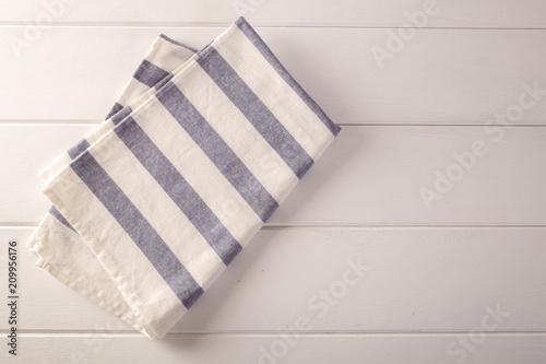 Fotografie, Obraz  itchen cloth (napkin) on white table