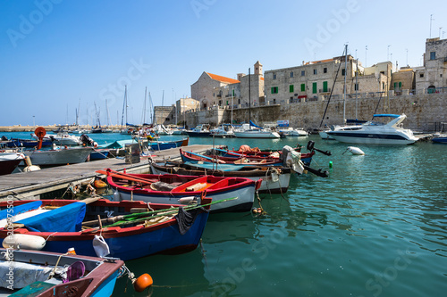 Poster de jardin Europe Méditérranéenne Colorful boats at Giovinazzo harbour with the Cathedral on the background, Apulia, Italy