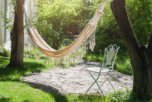 Summer Garden With Hanging Hammock For Relaxation. Lazy Time, Siesta. Beautiful Landscape, Sunny Day.
