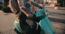 Young Couple Riding Retro Moto...