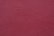 Burgundy Red Painted Stucco Wall. Background Texture