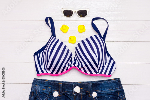 1fa8df410f Fashion. Summer clothes, Accessories set- Trendy Swimsuit Bikini on the  white wooden background