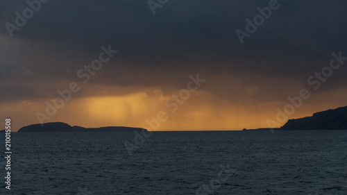 Fotografia, Obraz Dramatic colourful and stormy sunset over the Sound of Sunda with the Island of