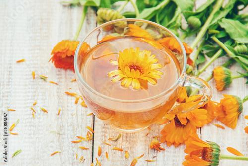 Obraz calendula tea and flowers. Selective focus.  - fototapety do salonu