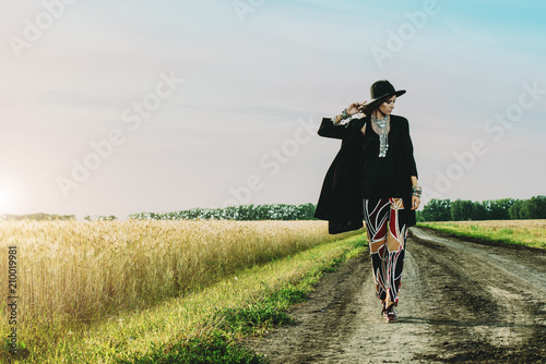 Fotobehang Gypsy girl walking on road