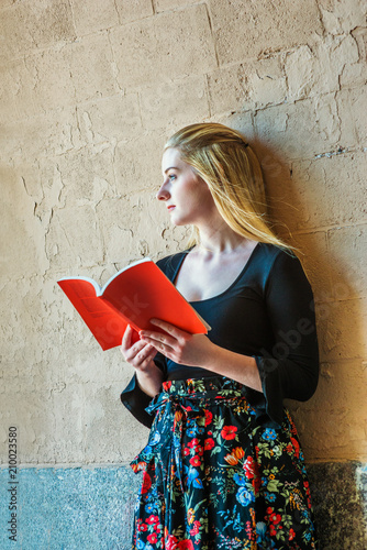 2578989eb2c American teenage girl with long blonde hair, white skin, reading book  outside in New York, ...