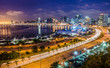 canvas print picture - Skyline of capital city Luanda, Luanda bay and seaside promenade with highway during afternoon, Angola, Africa