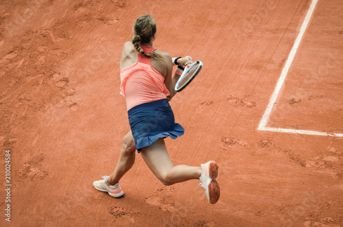 Backhand swing of woman playing tennis Wallpaper Mural
