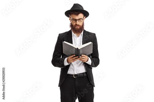 Fototapeta Religious man reading a book obraz