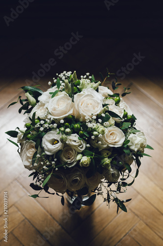 White roses bouquet on a glass jar