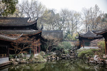 Traditional Chinese Architecture And Tea House Reflecting On A Pond With Red Carps (translation: Tea House)