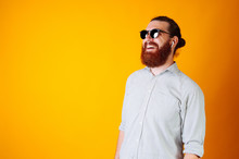 Portrait Of Smiling Bearded Business Man Wearing Sunglasses And Wireless Headphones