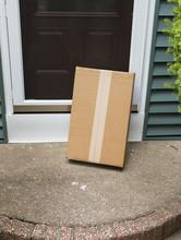 A Brown Package Is Left Vulner...