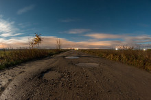 Dirt Road With A Lot Of Pits F...