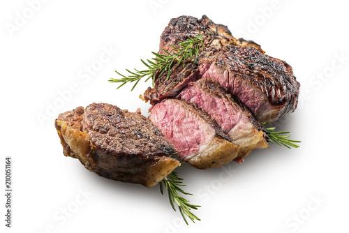 Sliced T-bone steak with rosemary