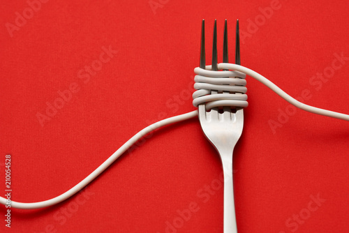 Fotografia Fork wrapped with cable
