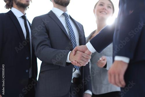 Fototapeta business leader shaking hands with the investor obraz
