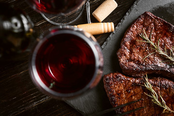 Fototapeta Do steakhouse dinner for two with steaks and red wine