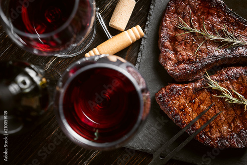 Fototapeta dinner for two with steaks and red wine obraz