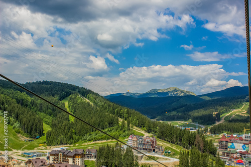 Deurstickers Bleke violet forest mountain nature landscape near mountain resort village with wooden cottages