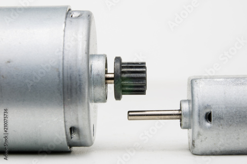 Fotografia  Small electric motor on a white workshop table