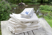 Stack Of White And Blue Linen ...