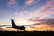Beautiful Landscape Image With Silhouette Of Old Wing Airplane At Sunset