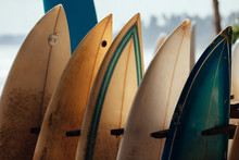 Set Of Different Color Surf Boards In A Stack By Ocean.WELIGAMA, SRI LANKA. Surf Boards On Sandy Weligama Beach In Sri Lanka. Surf Is Available All Year Around For Beginner And Advanced