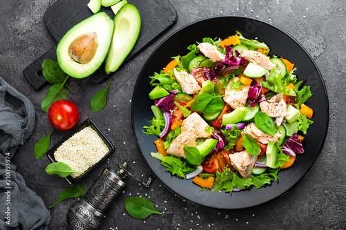 Tuinposter Klaar gerecht Salad with fish. Fresh vegetable salad with salmon fish fillet. Fish salad with salmon fillet and fresh vegetables on plate