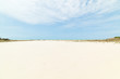 white sand blue sky. beautiful beach surface texture background for summer holiday and vacation concept.