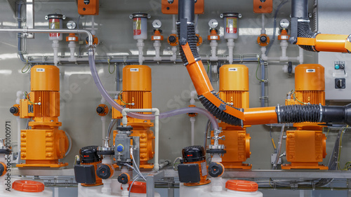 Fotografie, Tablou Orange pumps are in a row. Concept: industrial equipment