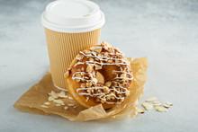 Almond And Caramel Glazed Donut With Cherry
