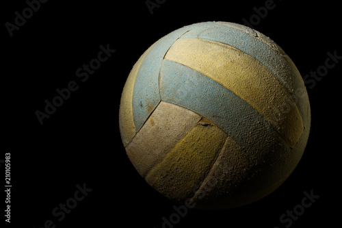 Old Volleyball on Black Background