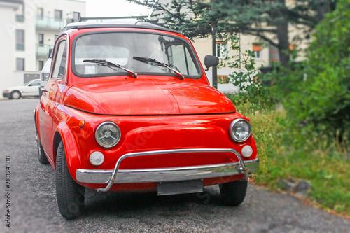 Deurstickers Oude auto s Small old retro red Italian car