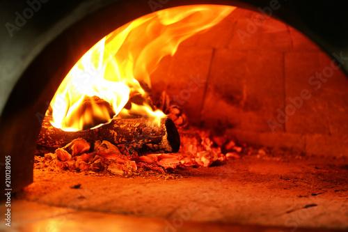 Foto auf AluDibond Pizzeria Oven with burning firewood in restaurant kitchen