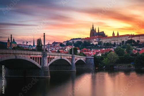 Poster Prague Beautiful golden view of the River Vltava and Manes Bridge after the sunset, Prague, Czech Republic, Europe