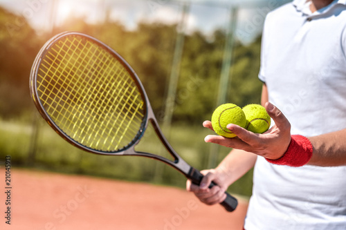 Fotografie, Obraz  Close up photo of young man on tennis court