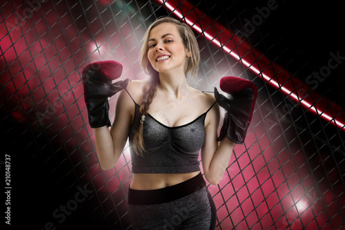 Cuadros en Lienzo Cheerful young girl mma fighter smiles