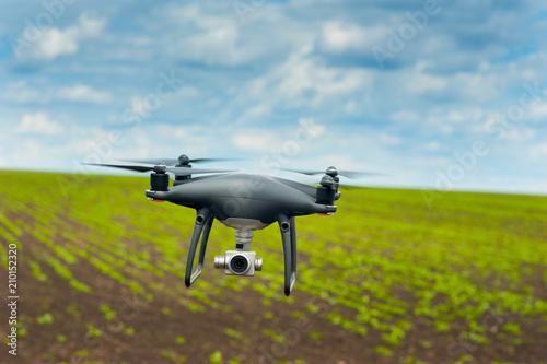 flight of drones over bean field crops Canvas Print
