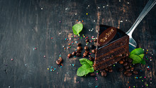Sacher Chocolate Cake. On A Wooden Background. Top View. Copy Space.
