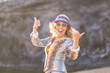 canvas print picture - Happy beautiful model under the sunlight in vacation or outdoor leisure activity. smile and laugh to the camera. colorful clothes like hippy style. Nice lifestyla and happiness concept