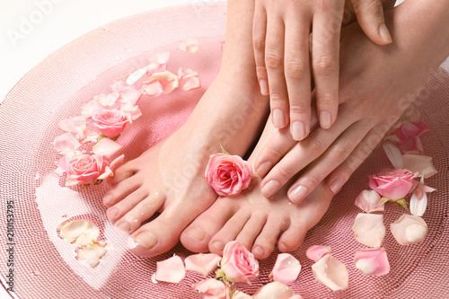 Foto auf Gartenposter Pediküre Young woman undergoing spa pedicure treatment in beauty salon, closeup